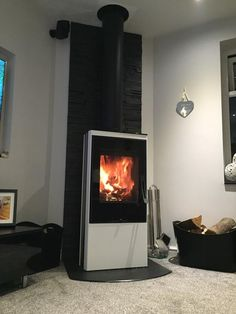 The Wood burning stove Contura 35 low with glass front. Winner at the Hearth & Home exhibition 2014. http://www.contura.eu/English/Stoves/Wood-Burning-Stoves/Wood-stove-Contura-35-low/
