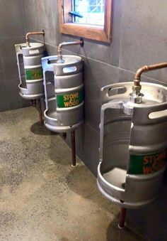 Keg toilet urinals made from old 11 gallon litre) beer kegs.