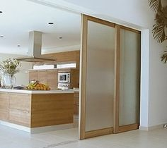 Sliding door to separate kitchen and living room