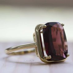 Super elegant solitaire ring set with a large natural Garnet gemstone. This Rich red garnet makes a bold statement in this fashion-forward cocktail ring.
