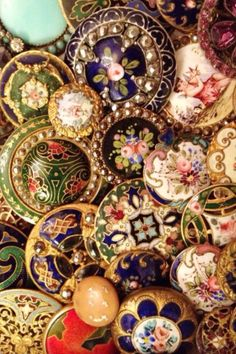 Antique gold and enamel buttons ( beautiful colours) would love these !!