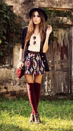 Navy blue coat, white t-shirt, aztec print skirt, burgandy knee-high socks and brown booties.