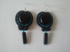 Gorgeous handmade earrings. They feature black glass beads surrounded with contrasting turquoise glass seed beads. To make this pair of earrings I have used black soutache.  This piece of jewelery is ideal for evening outings as well as everyday casual looks.  These earring a great gift idea.
