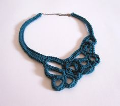 Beautiful OOAK hand crocheted necklace made of mercerised cotton in turquoise blue. Embellished with black beads. $30 via Etsy.