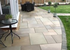 Raj Green sawn and honed Indian Sandstone. A special statement patio with an aff., Raj Green sawn and honed Indian Sandstone. A special statement patio with an aff. Raj Green sawn and honed Indian Sandstone. A special statement pat.