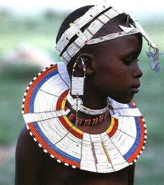 Africa | White Beadwork and Circular Scar on Cheek of This Maasai Girl, from the Kisongo Group  Photographic Print  by Nigel Pavitt