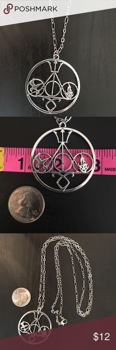 "My Many Fandoms 36"" Necklace This has a large 2"" radius charm which has symbols from all our favorite fandoms! Including Hunger Games, Harry Potter, Percy Jackson and Divergent! Comes on a 36"" silver chain. Jewelry Necklaces"