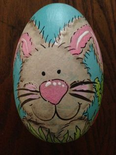 I love this happy bunny surrounded by colorful Easter eggs.  This is a handpainted wooden egg that measures 3.25 tall x 2.25 wide with a flat bottom that allows you to display it on a shelf.   You can choose pink or blue for the background color. The bunny is painted light brown with a pink nose. Each egg is sealed with a clear sealer for protection.  This egg is handpainted by me which means that each egg will be one of a kind. No two are alike so please allow for some differences from the…