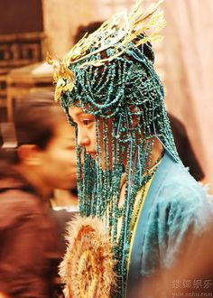 traditional Chinese headdress. green beading and gold highlights.