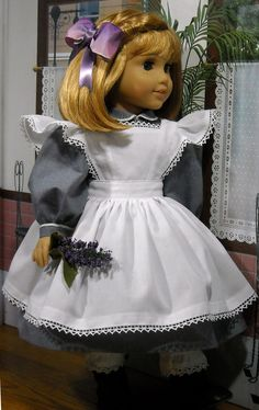 """We love the sweet white pinafore that Kathy K made for American Girl Nellie using our Pattern #1022: Cookie Time Apron, Pinafore and Oven Mitt for 18"""" Dolls (in our Etsy shop at https://www.etsy.com/listing/213964231/lp-pattern-1022-cookie-time-apron?). Kathy noticed that the ruffle is really a dart. Since darts are best stitched from the widest part to the vanishing point, why not sew this ruffle the same way — from the shoulder seam in both directions. Great tip, Kathy!"""