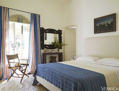 In the room of an Italian island villa, the headboard and curtains are Dedar fabrics and the chair is by De Padova. Serene Bedroom, Stylish Bedroom, Beautiful Bedrooms, Master Bedroom, Dream Bedroom, Italian Home, Italian Villa, Bedroom Decorating Tips, Bedroom Ideas