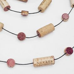Good use for synthetic corks: Wine Cork Garland 10' Garland for Mantle Cork by BoozyCouture