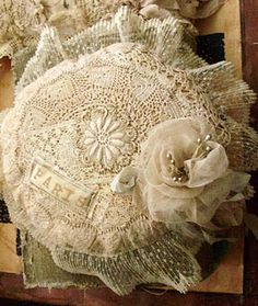 I have a lace pincushion just like this one, made from vintage lace back in the early 1980s