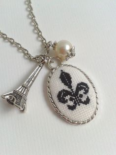 Fleur de Lis hand embroidered pendant necklace. $23.00, via Etsy.