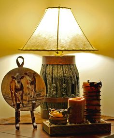 Wagon Wheel Hub Lamps with rawhide lampshade. $300-$400.  Visit www.facebook.com/greystoneimages to see more western home decor and lighting I make