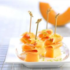 CANTALOUPE CARPACCIO BITES  Here's a fun variation on the classic cantaloupe/prosciutto pairing that serves as an elegant hors d'oeuvre.