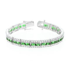 Emerald Tennis Bracelet – Fashioned in luminescent silver tone and three rows of assorted shimmer our Emerald Tennis Bracelet lends sassy tones to classic refinement. Our genuine rhodium finish is achieved using an electroplating process that coats the item with heavy layers of rhodium a close cousin of platinum that costs three times as much which gives our jewelry a platinum luster.