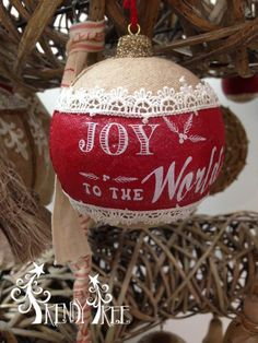"Joy to the World Ball Ornament Size: 4"" Color: Natural, Red Fabric covered ball ornament trimmed in lace with Christmas wording."