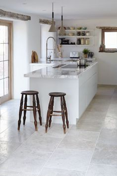 gray tile floor kitchen. Surface mottling  small shells and veining make for a forgiving stone floor that is equally 9 Kitchen Flooring Ideas White quartz Glass Pavilion