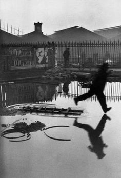 FRANCE. 1932. - FRANCE. Paris. Place de l'Europe. Gare Saint Lazare. 1932.    - Exterior, Jump, Man - 45 to 60 years, Paris ( all), Puddle, Rain, Reflection (image), Running, Silhouette, St Lazare station, Wet, White people