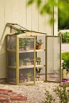 Patio Grow House. //  (Good way to start seeds and harden off plants!)  Double-wall glazing insulates against the chill; multiple vents prevent overheating.