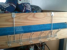 Hang an over the door rack off a bunk bed or loft bed for robes, hats, towels, etc.