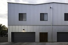 Image 33 of 46 from gallery of Kenneth Place Townhomes / Chen + Suchart Studio. Photograph by Matt Winquist Success Poster, Metal Cladding, Photo Studio, Chen, Townhouse, Garage Doors, Gallery, Building, Places