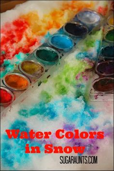 Painting snow with watercolors.  This is a great indoor or outdoor activity for kids of all ages! By Sugar Aunts.