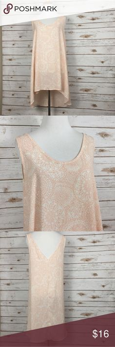 new | Deep V Neck Long Mandala Tunic Tank Beautiful deep v neck and back tank top. Long as shown in the picture. The pattern is a dream catcher or mandala type pattern and is gorgeous! It would look beautiful over a pair of jeans! Tops