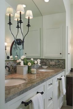 Create an arch over the sink.  great place to put a corner cabinet where the dead space is.  love the light sconce adhered to the glass.