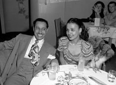 Cab Calloway with Lena Horne in the 1940's.  original photo taken by Michael Ochs. Photo obtained from Vintage Black Glamour.
