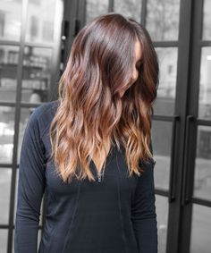 """""""light, golden-toffee blond ends over natural auburn hair"""" — the perfect example of an on-trend take on bronde."""