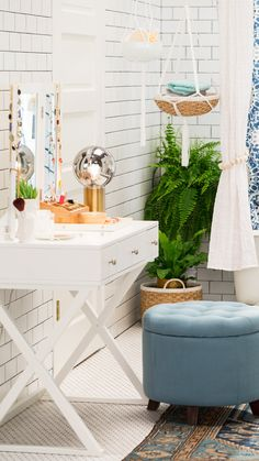 Glam meets function with this beauty vanity—no construction necessary! A chic white desk and blue storage ottoman are all it takes. How's that for luxe? Click to find even more decorating tips and tricks for creating a beautiful new look in your own bathroom.