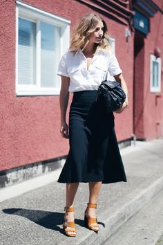 Summer may have been the season of the mini, but this fall, it's all about midi skirts that hit below the knee. Wear yours with everything from a crisp white button-down to your favorite lived-in graphic tee. | @andwhatelse