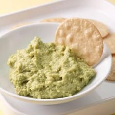 Edamame-Ginger Dip: 8 ounces frozen shelled edamame; 1/4 cup water; 2 tablespoons reduced-sodium soy sauce; 1 tablespoon minced fresh ginger; 1 tablespoon rice vinegar; 1 tablespoon tahini; 1 clove garlic; 1/8 teaspoon salt; Hot pepper sauce to taste: Cook edamame to package directions. Puree all in a food processor until smooth. Chill for 1 hour before serving.