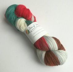 Hand dyed yarn. 100g of silver sparkle sock yarn. Superwash merino/nylon/stellina. UK dyer. I've Come At Last red, green, brown, grey, white by FeltFusion on Etsy