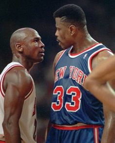 Michael Jordan and Patrick Ewing exchange angry glares during a heated playoff game. Jordan always owned the Knicks,
