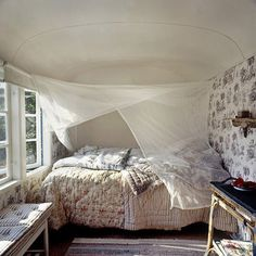 cozy little nook. i would love to curl up in there and nap in the afternoon sun. just peacefulness.