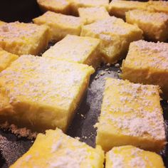 Cheesecake Lemon Bars with a Dusting of Powdered Sugar