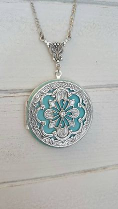 Check out this item in my Etsy shop https://www.etsy.com/listing/454579330/tiffany-vintage-style-locket-necklace