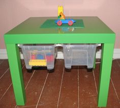 samla boxes and rails mounted under ikea table to provide easy access storage for toys, books, crayons etc. whatever the kids are using the table for!
