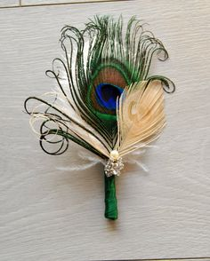 https://www.etsy.com/listing/251879586/peacock-groom-wedding-boutonniere?ref=shop_home_active_71