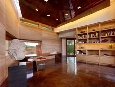 This modern and wonderful studio, covering an area of 500 square feet, forms part of an extension added to a home by Carney Logan Burke Architect in Jackson, Wyoming, USA. The home uses adobe – a natural and sustainable construction practice that consists of a mixture of moist earth, sand, gravel, and clay – for its walls, concrete for its floors, and copper for its roofing, creating a unique space..