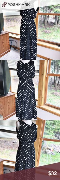 NWOT. My Michelle sleeveless polka dot dress, 12 NWOT. My Michelle size 12 sleeveless dress. Black with white polka dots, keyhole at nape of neck. Elastic waist and decorative matching belt. Pleated skirt. My Michelle Dresses