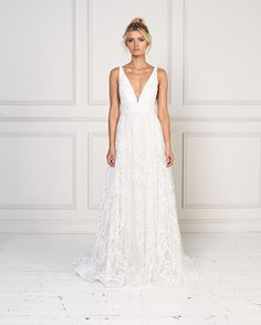 d32269ce0b V-neck A-line beaded wedding dress available at Kleinfeld Bridal.
