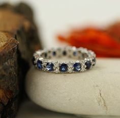 Items similar to Sapphire And Diamond Eternity Wedding Band Ring In White Gold Blue Sapphire Eternity Band Diamond Anniversary Ring Size on Etsy Sapphire Eternity Band, Eternity Bands, Diamond Anniversary Rings, Anniversary Bands, White Sapphire, Sapphire Diamond, Wedding Ring Bands, Band Rings, White Gold