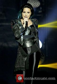Demi Lovato performing live at the Manchester Arena