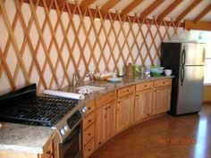 quite a large kitchen space, curved, no wall cabinets