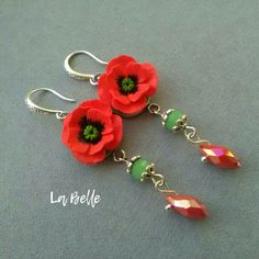 Bright earrings with poppies will delight you and those who surround you, and give you memories of summer