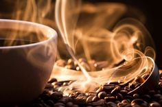 Love this picture of a cup of coffee and coffee beans. You can almost smell the aroma!